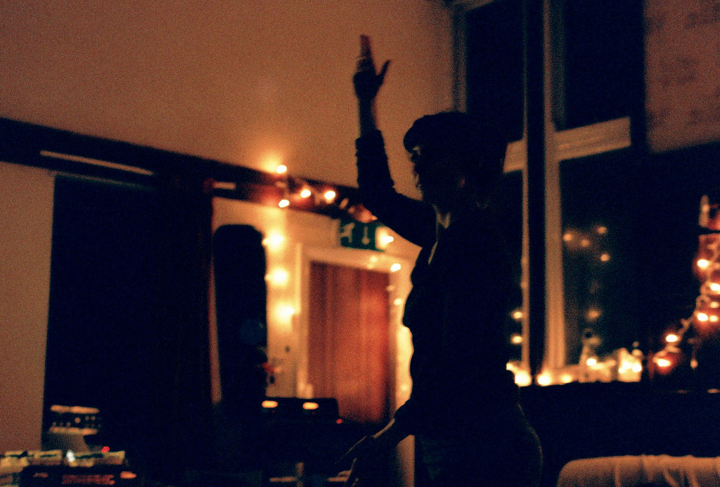 My friend dancing alone at a party. for Nine of Pentacles tarot card